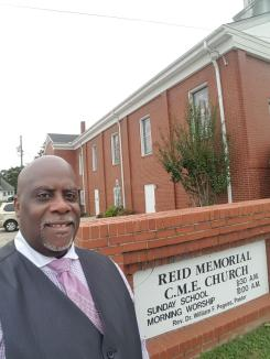 Pastor in Front of Church