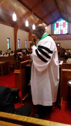 Pastor in white robe